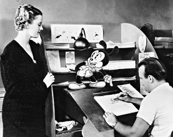 Actress Phyllis Brooks visits with Oswald and Tex Avery in this rare 1934 publicity photo - click to enlarge (courtesy of Devon Baxter)
