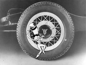 """A scene from """"The Rhapsody of Steel"""" of the Ford V8 man orchestrating the assembly of a Ford Motor Car in stop motion."""