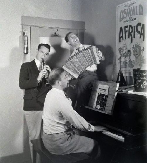 Pinto Colvig (clarinet), Walter Lantz (accordion) and James Dietrich (piano) at the Universal Cartoon Dept. in 1930.