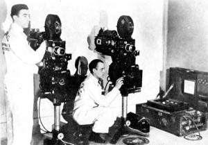 Photograph showing a suit case projectionist set up for non-theatrical screenings.