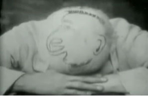 Screenshot from Le Rêve des Marmitons showing a face drawn on a bald head.