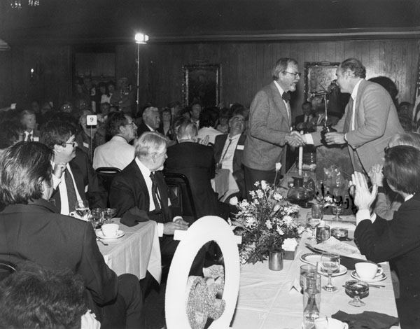 Chuck Jones getting his Golden Award from Bud Hester. (Looks like the back of Zamora's head on left.) This photo and  all others in this post by Ruben Apodaca