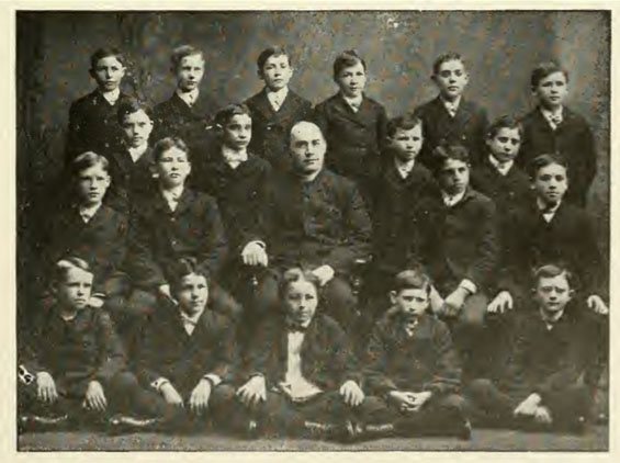 FIRST COMMUNION CLASS, 1904, ST. MICHAEL'S CHURCH.  Vincent Whitman is in the middle row (far right). His brother Stewart is in the top row (third to the left)