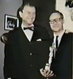 "Chuck Jones lets Al Pabian hold his Oscar for ""The Dot & The Line"" (1965)"